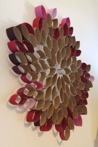 Toilet paper/paper towel rolls made into a fun wall sculpture - I like this, but i would paint the inside as well on all of them... or maybe not.. lol.. depends on background, where it is etc. One cool idea - maybe - would be to paint them all in exact (or as exact as possible) colour as the wall.
