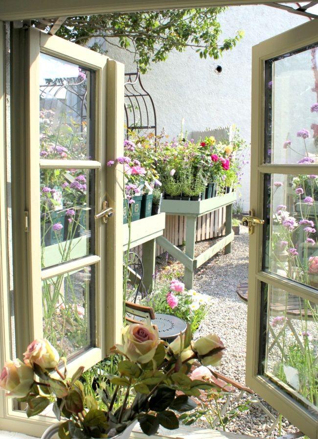 Window view to La Vie en Rose Garden