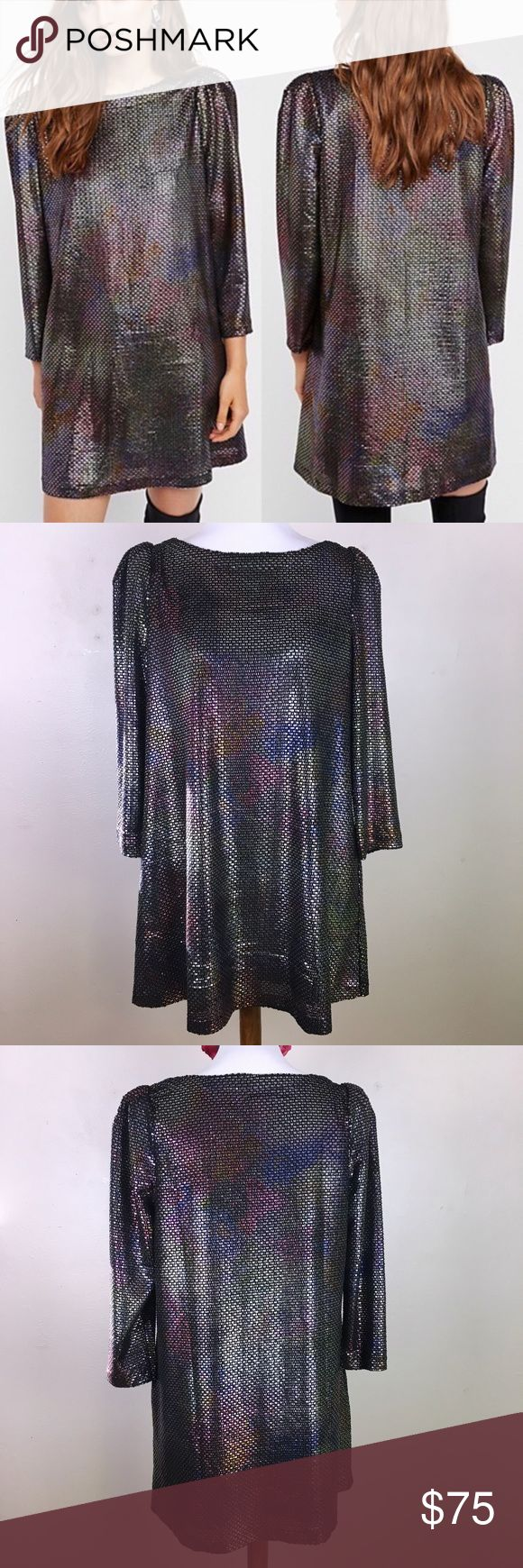 """NWT Free People Metallic Long Sleeve Sheath Dress Long sleeve metallic mini dress. NWT. Medium. Silver color with rainbow sheen. Structured shoulders and swing silhouette. Side pockets!  ▪️Pit to Pit: 21"""" ▪️Length: 34"""" ▪️Condition: NWT. Excellent condition. Free People Dresses Long Sleeve"""