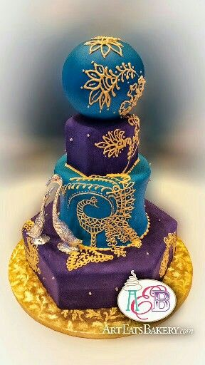 Blue and purple fondant #Indian #Mendhi style 4 tier hexagon and round custom unique wedding cake with silver pearls, silver birds (not edible), gold royal icing peacock and flowers piping Http://www.arteatsbakery.com  2830 Wade Hampton Boulevard, Taylors, SC #Greenville #sc #Bakery #taylors #unique #greer #yeahthatgreenvill #eatthatgreenville #wedding #cake #birthday #birthdaygirl  #Clemson