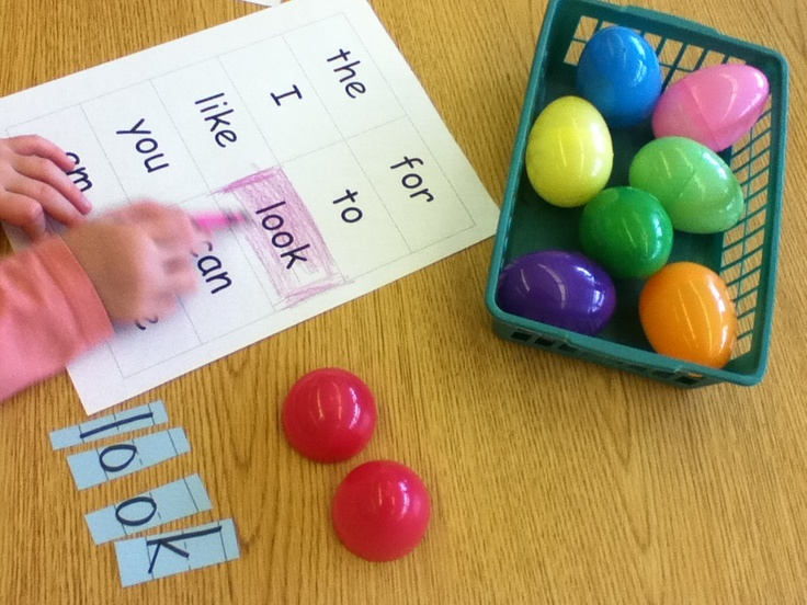 Sight word scramble.  Write sight words on sentence strips.  Cut them up putting the letters of each word in a seperate egg. For the first time playing I gave them a word bank where they could find the word off the list and color it. After playing once or twice they shouldn't need the bank.