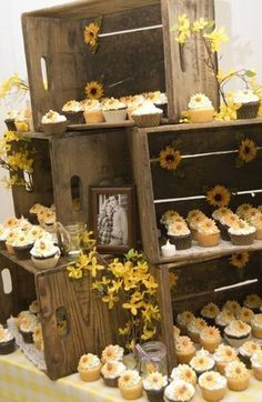Rustic wedding reception. Awesome way to display cupcakes, if I went the cupcake route. So pretty!