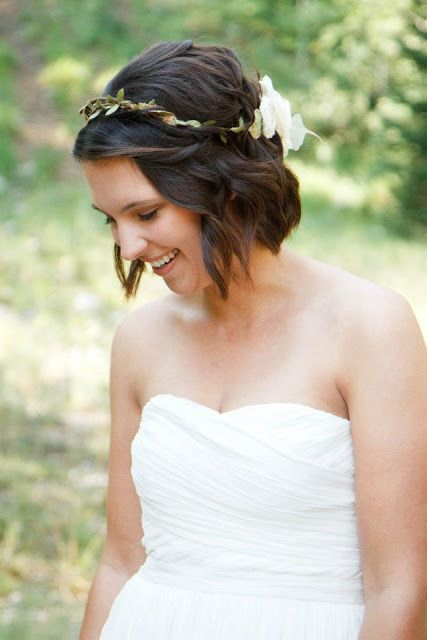 wedding hair - short bob.  not big on the flower wreath, but I like the style.