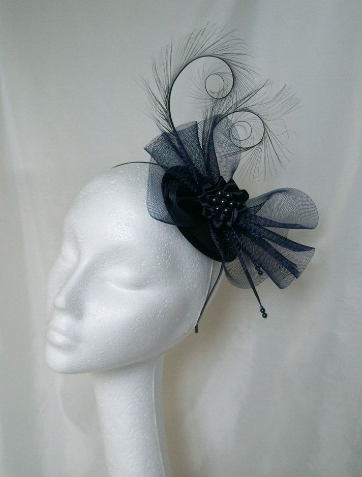 Navy Blue Matilda Fascinator Mini Hat, Order Now from www.indigodaisyweddings.co.uk Specialising in stunning bespoke cocktail fascinators and formal hats in a wide range of colours, perfect for Royal Ascot and The Kentucky Derby. Plus all your wedding floral accessories including shoe clips, vintage flapper bands, feather and flower fascinators, feather fans, fairy wands, wrist corsages, wedding bouquets & buttonholes. Worldwide Delivery.