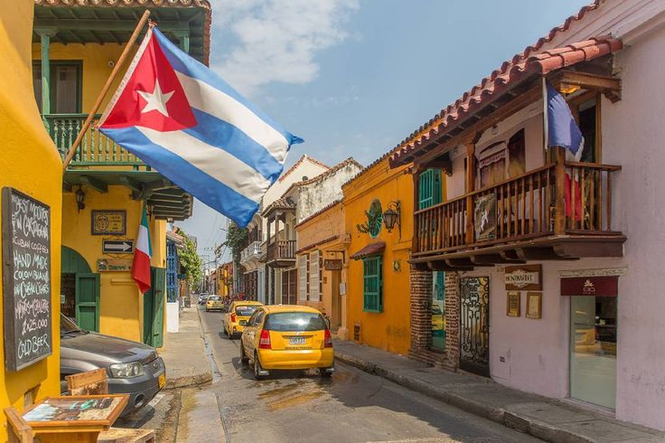 Can't quite put my finger on it but something about this street in Cartagena reminds me of Cuba  Cartagena Colombia.  #Colombia #cartagena #town #building #cuba #flag #urban #flightlesskiwis #wanderlust #whateveryouradventure #getoutside #neverstopexploring #adventure #lifeonttheroad #travel #traveling #instatravel #instago #instagood #trip #holiday #photofotheday #tourism #tourist #instapassport #instratraveling #mytravelgram #travelgram #igtravel