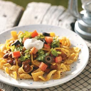Camping Haystacks. Could make a really good lunch, especially if you look for a low sodium version of the chili, use low fat/fat free cheese and sour cream, and maybe swap the fritos for tortilla chips.