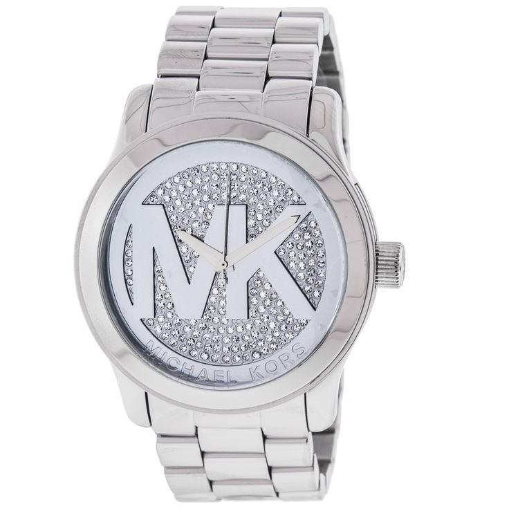 """This beautiful timepiece features a dazzling display of crystal stones on the front as well as reliable quartz movement. Complimented by a stainless steel bracelet and """"MK"""" logo on the dial."""