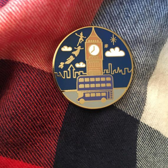What is your favorite way to get around London? Maybe it is with the help of some pixie dust ? Or maybe its a crazy nighttime ride on the Knight Bus! Whichever you prefer, this pin depicts both of these magical forms of transportation on a beautiful London night. This pin will go