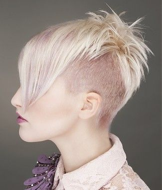 A short blonde straight coloured multi-tonal choppy shaved-sides womens haircut side-view hairstyle by William De Ridder