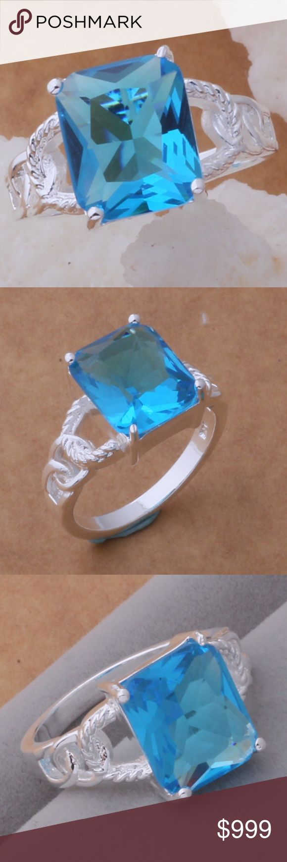 """COMING SOON!! Sterling Silver Blue CZ Ring Coming Soon!! (Price available upon arrival). Brand new in original packaging.  Beautiful 925 stamped sterling silver statement cocktail ring featuring an emerald brilliant cut sky blue cubic zircon crystal stone set in a 4 prong tension mount setting on an exquisite, elegantly designed band.  Size 8. Weight: 5.4g.  """"Like"""" to be notified of arrival! Jewelry Rings"""