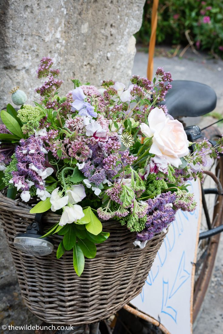Wedding garden flowers - Country Marquee Weddings And Rusty Old Bikes Signposting The Venue Work So Well A Tasteful Display Of Garden Flowers In The Basket Just Tops It Off