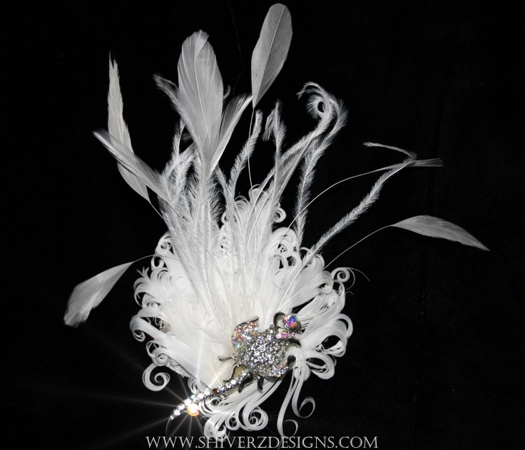 Rose Glow Fascinator    Nagorie feather with ostrich fringe & stripped plumes. Finished with an elegant  Ab crystal rose brooch