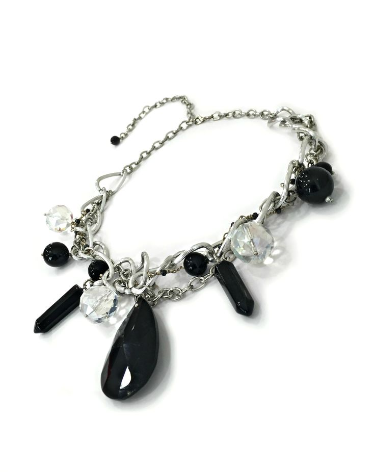 a handmade necklace with one TRIFIN black crystal, black onyx & crystals