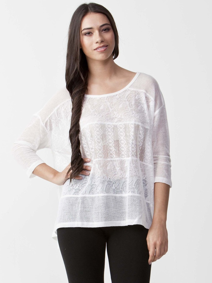 Serena - Light Chiffon Top with round neckline. Features long length sleeves with detailed trim. Regular fit cut and hip length. $49.50