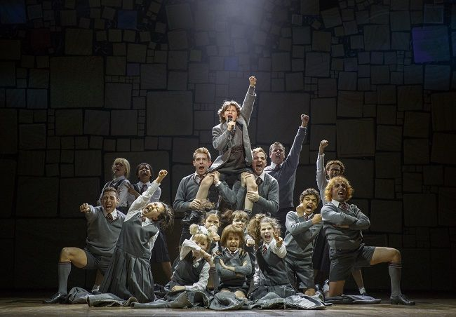 """http://triangleartsandentertainment.org/wp-content/uploads/2017/05/Matildathe-MusicalPHOTO6-BSSandNCT2017.jpg - NC Theatre's Matilda Has Lots to Love - The Matilda the Musical cast performs """"Revolting Children"""" (photo by Joan Marcus) Onstage now through North Carolina Theatre, under the direction of Matthew Warchus, Matilda, based on the book of the same name by Roald Dahl, is just as fabulous as ever. And, while diehard fans of the... - http://triangleartsandente"""