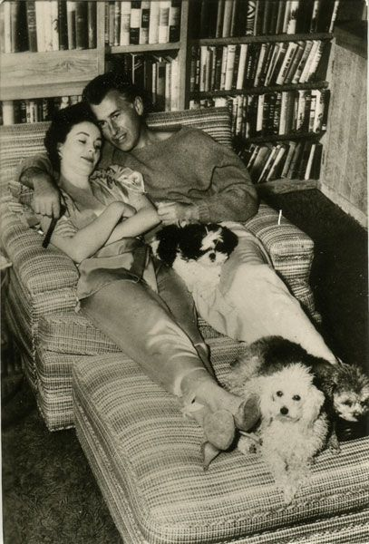 Stewart Granger and Jean Simmons relaxing at home with their pets.