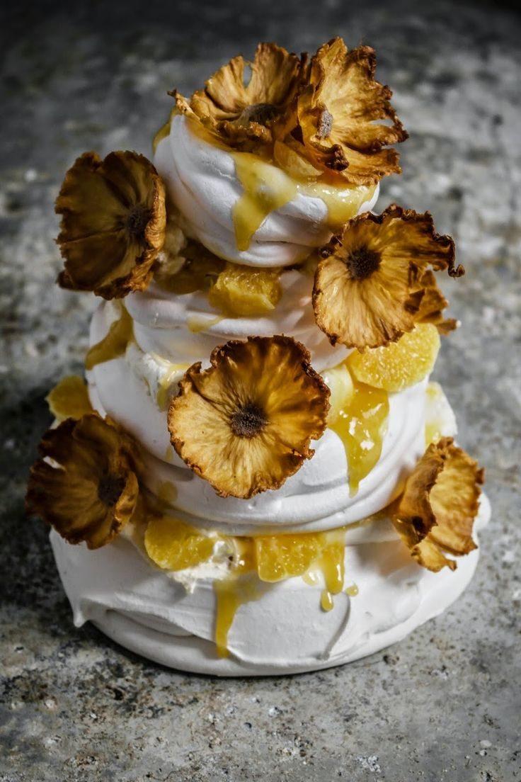..Twigg studios: four layered pavlova with pinapple orange curd and dried pineapple flowers