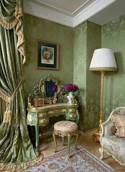 Jade green French room with damask wall covering, formal swag drapery and light colored Persian rug