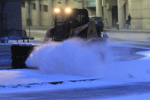 A giant snow brush keeps sidewalks clean around the Rhode Island Convention Center in Providence.