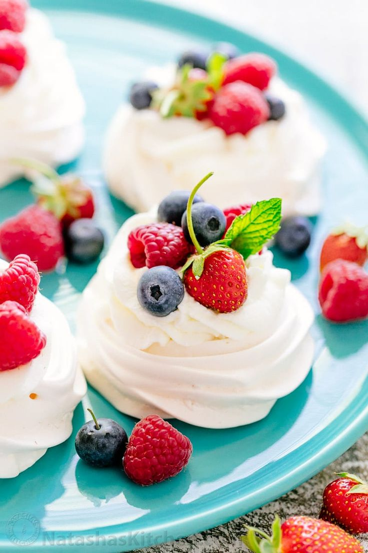 Pavlova is a showstopping meringue dessert and is easier than you think! Mini pavlovas have crisp shells and marshmallow centers. They melt-in-your-mouth!