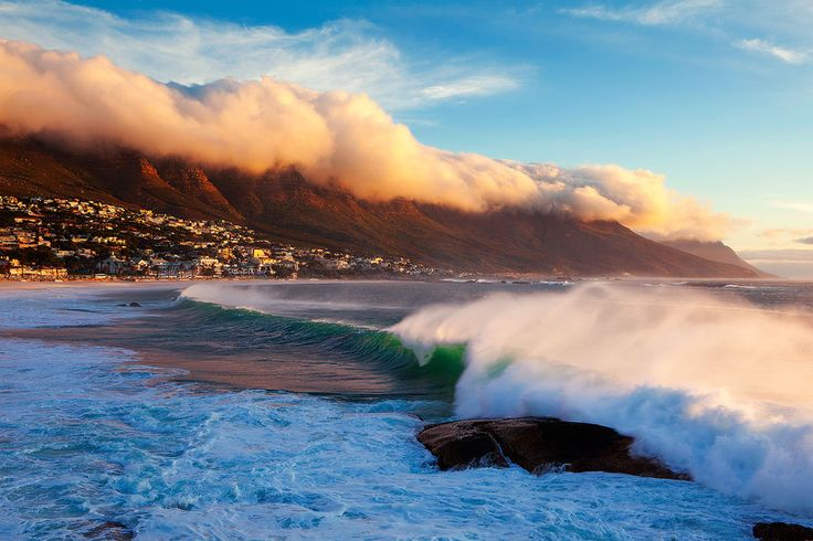 Camps Bay Massive waves roll into Camps Bay and the clouds start forming against the apostles in a strong South-East wind, signalling the approach of a cold front.