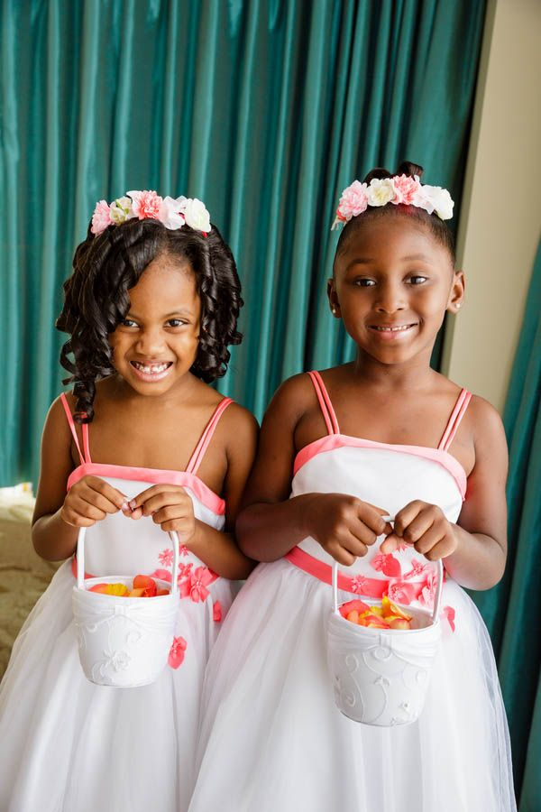 These flower girls look adorable with their pink and white flower crowns!