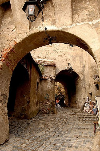 Archways in Sighisoara, Mures county, Romania. (I will go to Romania one day! -K)