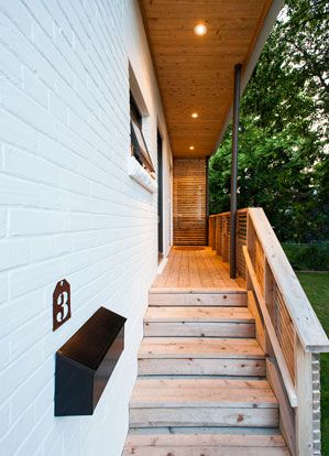 Our House, newly painted white! Passive Solar Design | Sustainable Building | Solares Architecture