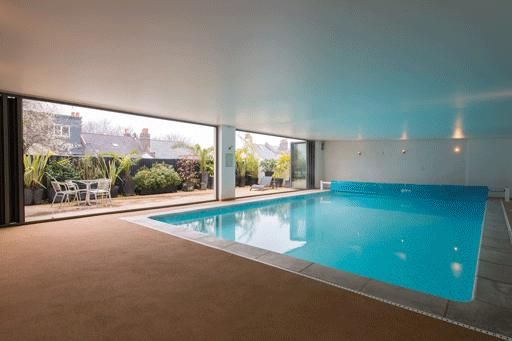 Milner Road 038: Modern indoor swimming pool set inside this fantastically styled 1970s house!