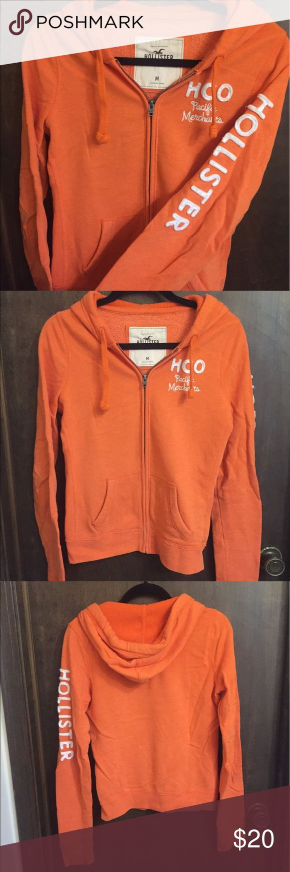 Orange hollister zip up hooded sweatshirt Women's Hollister sweatshirt, zip up with a hood. Size M, hollister written on left arm and near chest. No visible signs of wear. Willing to negotiate! Hollister Tops Sweatshirts & Hoodies