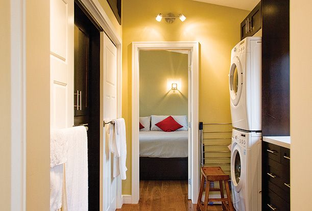 Laneway Loft - The master dressing room has clothes storage, towel bars, laundry facilities, a small sink and even an wine fridge and espresso maker!