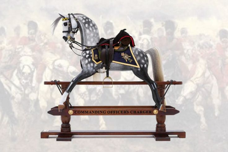 The Royal Scots Dragoon Guards Grey. Inspired by The Charge of the Light Brigade, the first horse in this limited edition of only 20 pieces was commissioned by Michael Mockridge MBE to raise funds for the Royal Scots Dragoon's charity 'Caring for Courage.' The secret 'bottom drawer' of the horse contains a bottle of Malt Whisky and a pair of engraved tumblers. Other contents have included jewellery, keepsakes and cigars.