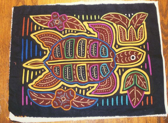Example of a mola made by the Kuna Indians of the San Blas Islands, Panama.  Their handiwork and art is colorful and detailed.