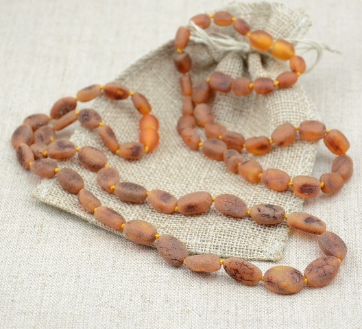 """Amber teething necklaces.. they work! Amber is not a """"stone"""" but a natural resin. So as it warms with the body's natural temperature, amber releases its healing oils (these oils contain succinic acid )which are easily absorbed into the skin and then into the bloodstream."""
