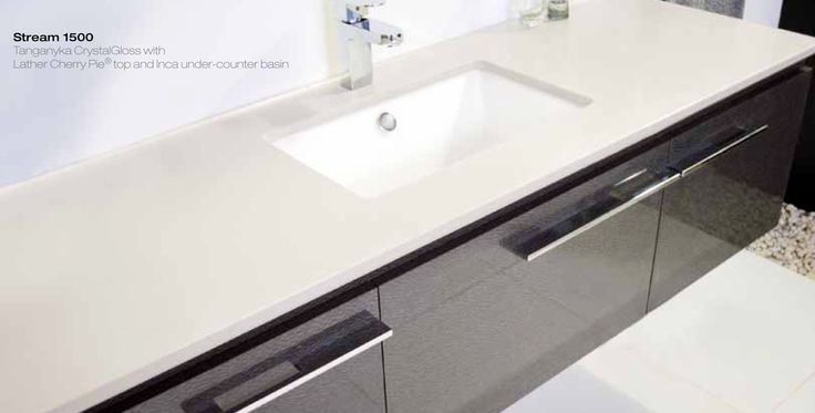 ADP double sinks in 1800 cabinet ceaserstone top and 'driftwood' front