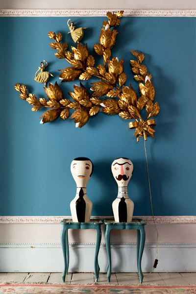 The perfect blue wall, an old pressed brass wall light with necessary ballerinas on, a couple of kooky suited timber men and a matching pair of Queen Anne side tables.
