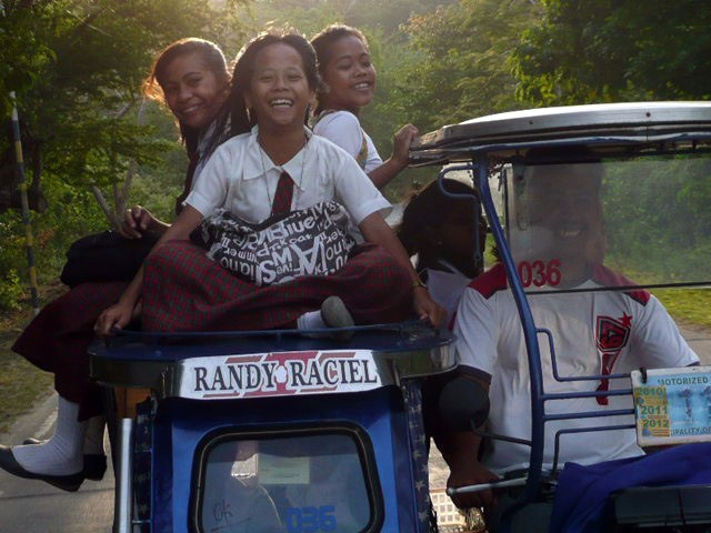 Philippine girls getting a ride home from school. Mindoro