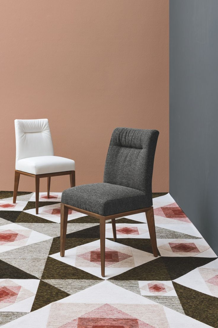New Tosca chair from Calligaris with wooden base and seat in  fabric or leather.