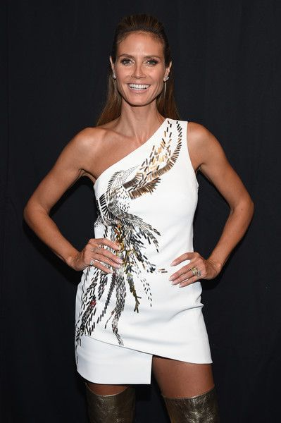 Heidi Klum poses backstage at the Project Runway fashion show.