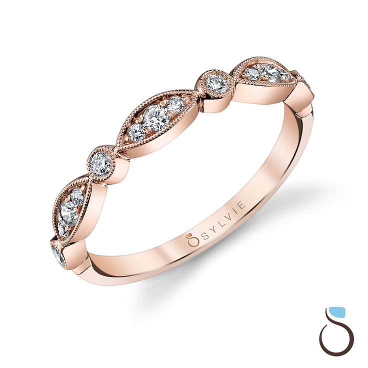 This stackable #rose #gold #wedding band with shimmering diamonds in alternating marquise and round settings makes the perfect complement to any of our #stunning #engagement rings!   sylviecollection.com (Style no. B0011)  #SylvieCollection #SomethingSylvie #Jewelry #Diamonds #IDo #Proposal