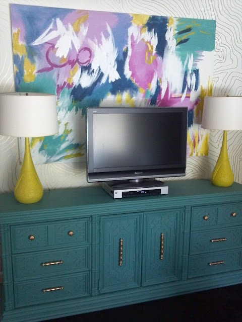 Love the giant painting and the pop of color! Maybe use candles instead?