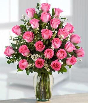 Two Dozen Pink Roses Nobody can resist sweet roses, their perfume filling the air. Our two dozen pink roses is a tender gift that can't help but prove your love. Simple and elegant, the roses come in a clear glass vase, ready for display in the home. Send two dozen pink roses to express your love in no uncertain terms!