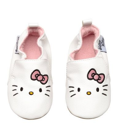 White/Hello Kitty. Soft slippers with elastic at top edge and a loop at back. Terry lining, terry insoles, and soft faux suede soles.