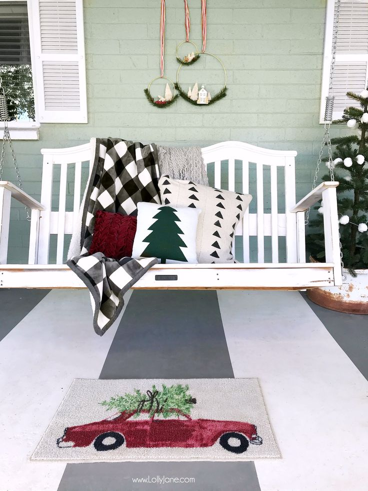 This Christmas porch is just simple and pretty! Mix handmade decor with store bought to make it pop! Love those bottle brush tree wreaths!  LOVE this buffalo check #BHGLiveBetter throw from Walmart, so cute! #ad