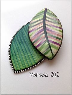 by Marisela, Ikat pendant. Made from polymer clay. See too Sandra McCaw.