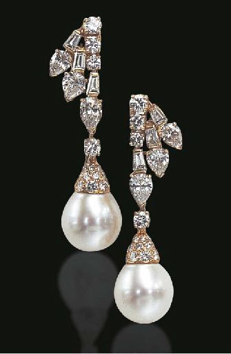 A PAIR OF CULTURED PEARL AND DIAMOND EAR PENDANTS Each detachable drop-shaped cultured pearl pendant, measuring approximately 13.00 mm, enhanced by a pavé-set diamond cap, suspended by a diamond collet, from a circular, tapered baguette and pear-shaped diamond surmount of spray motif, mounted in gold