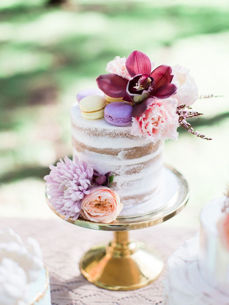 Naked wedding cake with macarons and pastel flowers | We Are Origami | See more: http://theweddingplaybook.com/pastel-bohemian-wedding-inspiration/
