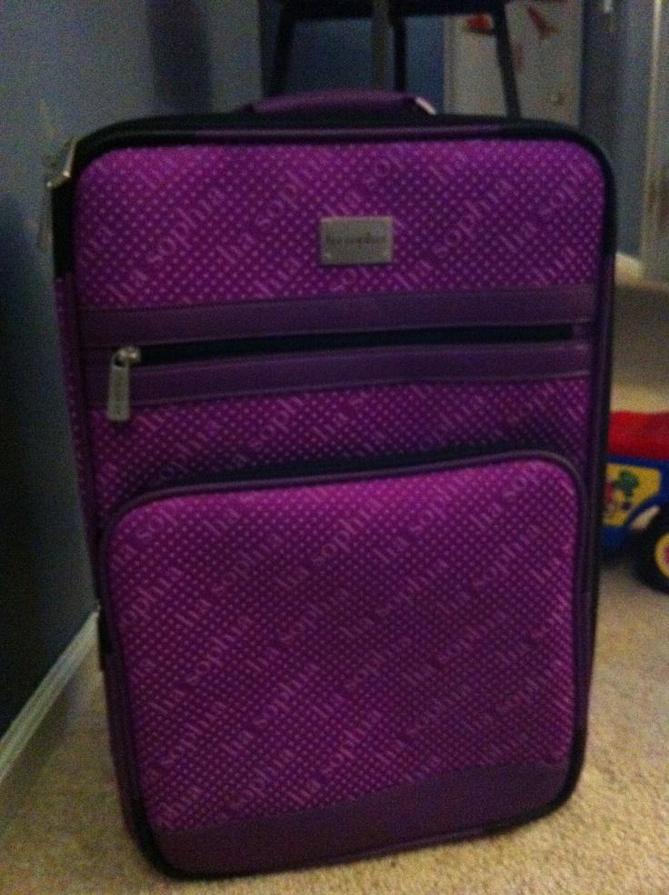 Lia sophia purple luggage - that's how I roll!  I have mine, next stop HAWAII!!!  Wanta come too.  contact me for info:  www.liasophia.comtwl