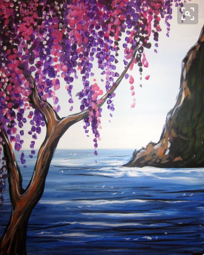 Beautiful serene painting of pink and lavender flowers on a wispy tree, with a large rock in the water in the background.