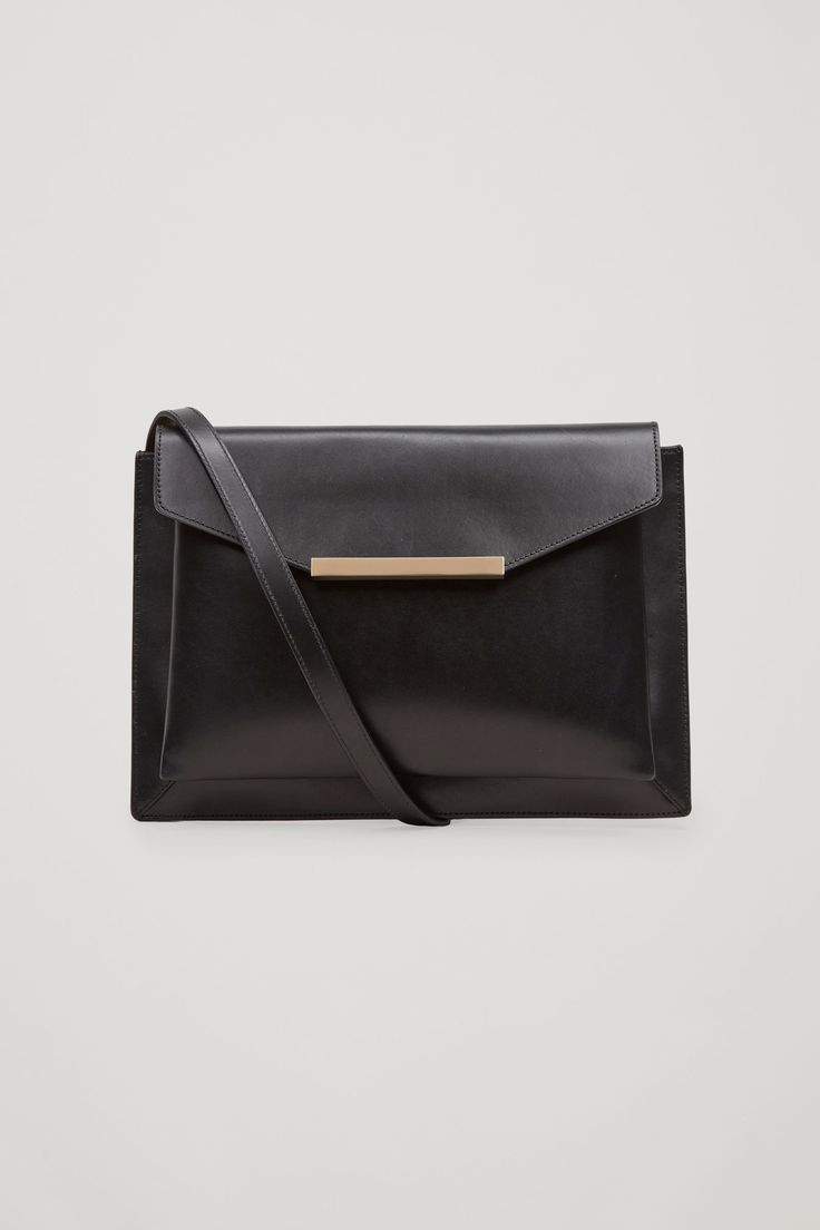 COS image 1 of Layered leather bag in Black